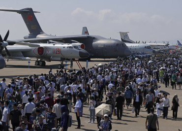 Visitors attend the 12th China International Aviation and Aerospace Exhibition, also known as Airshow China 2018, Tuesday, Nov. 6, 2018, in Zhuhai city, south China's Guangdong province. (AP Photo/Kin Cheung)